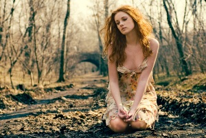 sadness woman on forest floor